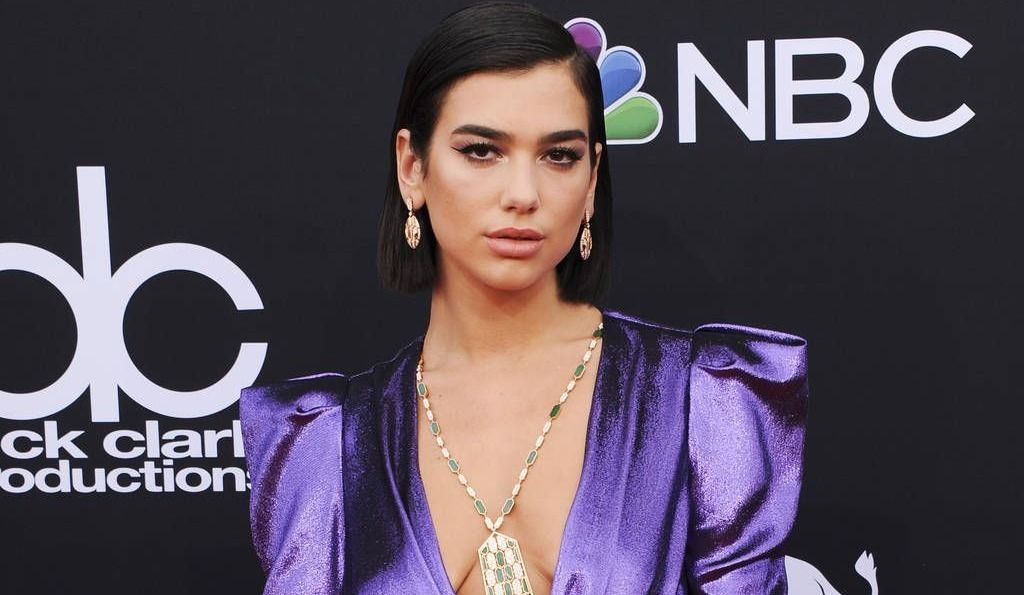 Dua Lipa tweets about love after boyfriend is caught dancing with mystery woman